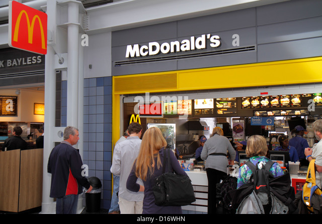 Chicago Illinois O'Hare International Airport ORD concourse gate area McDonald's fast food restaurant line - Stock Image
