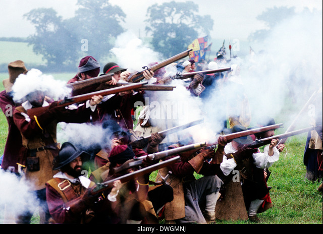 English Civil War, musket fire in battle, 17th century, battles firing muskets, historical re-enactment soldier - Stock Image