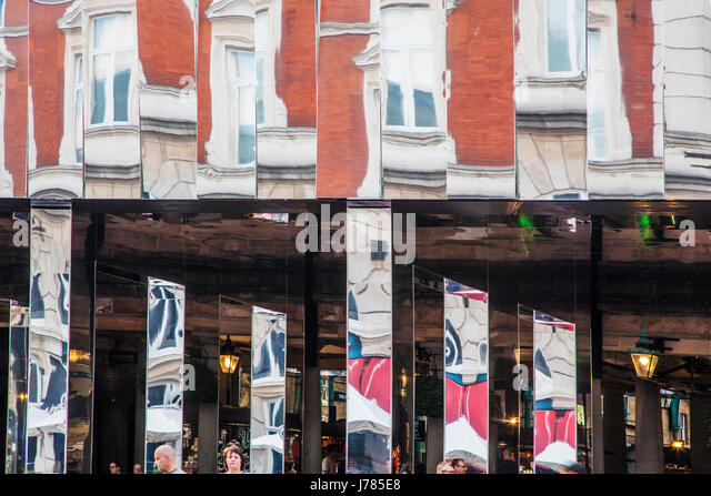 Distorted reflections in the mirrors of the Reflect London installation in Covent Garden. - Stock Image