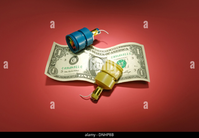 A US one dollar bill with party favors. - Stock Image