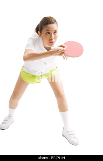 Young woman with table tennis racket, studio shot - Stock Image