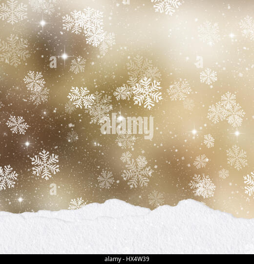 Mounds of snow on a gold Christmas background with stack of presents - Stock Image