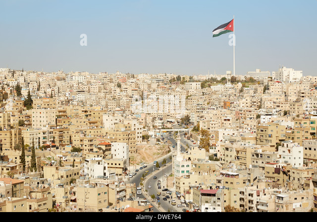 Amman city view with big Jordan flag and flagpole - Stock Image