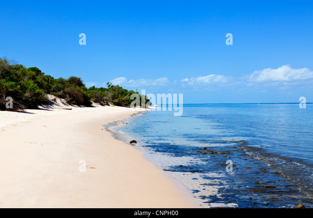 A deserted island beach in the Mozambique archipelago. - Stock Image