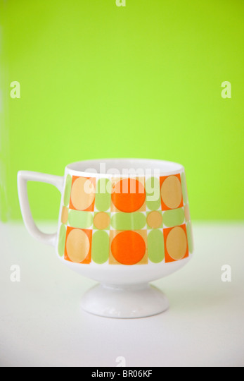 modern retro coffee cup with bright colors - Stock Image
