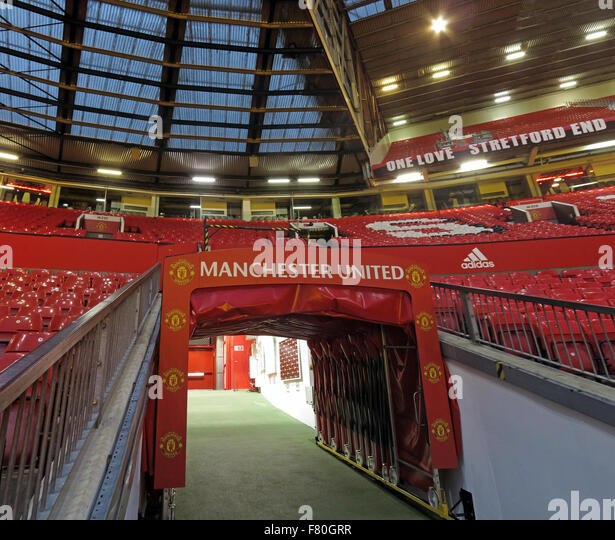 Manchester United,Old Trafford,Players Tunnel and Stretford End - Stock Image