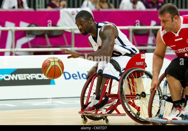 USA's Matt Scott dribbles down court against Turkey (red)in a wheelchair basketball game at the 2012 London - Stock Image
