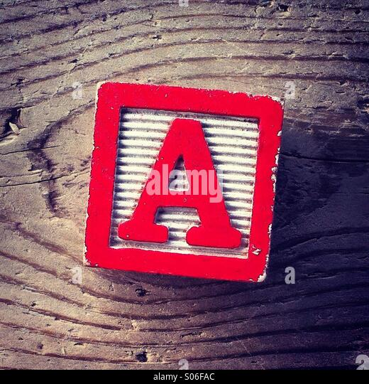 It's a woodblock toy with an alphabet letter on it: A - Stock Image