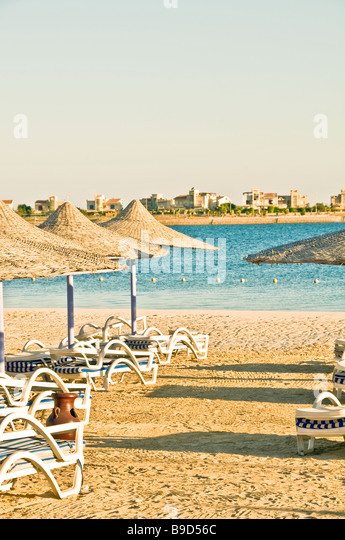 beach chairs umbrellas Egypt North Coast Porto Marina Resort and Spa hotel - Stock Image