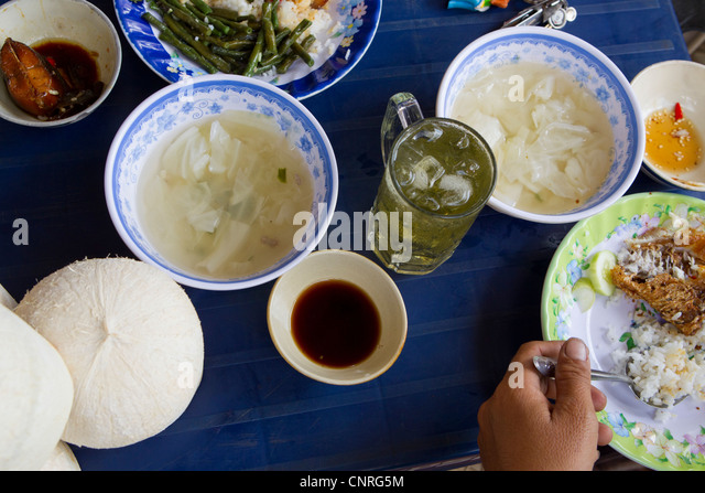 Person eating street food - Stock-Bilder