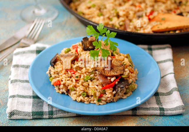 Paella with wild mushrooms. Recipe available. - Stock Image