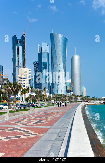 View along the Corniche towards the new skyline of the West Bay central financial district, Doha, Qatar, Middle - Stock Image