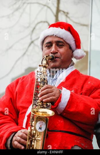 Saxophone christmas xmas stock photos amp playing saxophone christmas