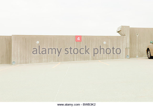 Empty car park with number 4 parking space - Stock Image