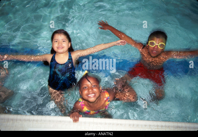 New Jersey Paterson Boys and Girls Club swimming pool children Black female fun - Stock Image