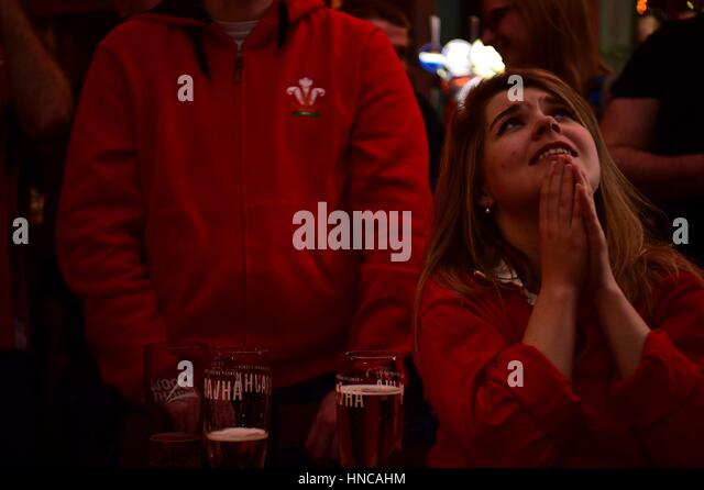 UK Sport: Disconsolate Rugby fans watching Wales playing against  England in the Six Nations rugby international - Stock Image