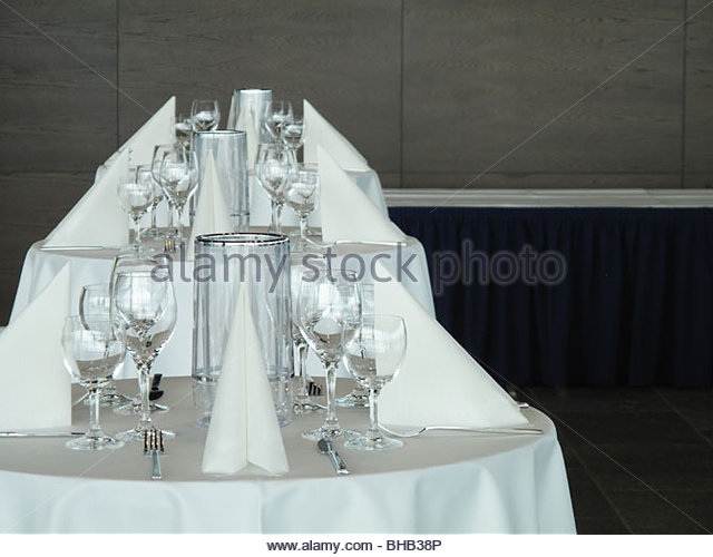 Place settings on banquet tables - Stock Image