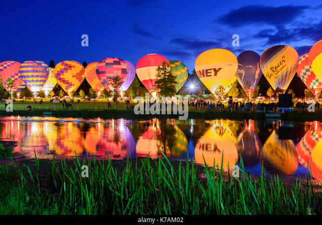 Longleat, Wiltshire, UK. 14th September 2017. A row of illuminated hot air balloons are reflected in the lake at - Stock Image