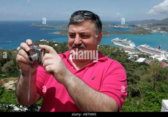 St. Thomas USVI Paradise Point man camera Charlotte Amalie Harbor Caribbean Sea cruise ships - Stock Image