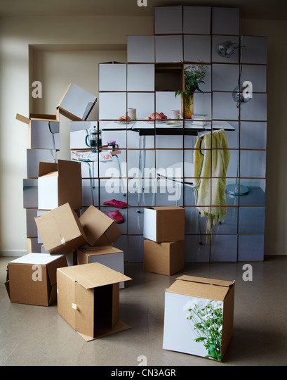 Stack of cardboard boxes with pictures on them - Stock Image