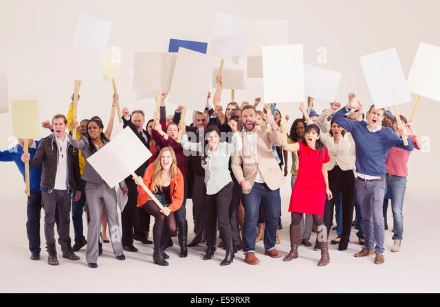 Protesters with picket signs - Stock Image