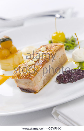 pork served with condiments - Stock Image