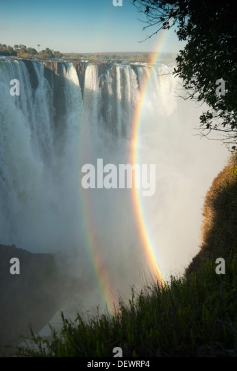 Double rainbow in afternoon light, Victoria Falls, Zimbabwe - Stock Image
