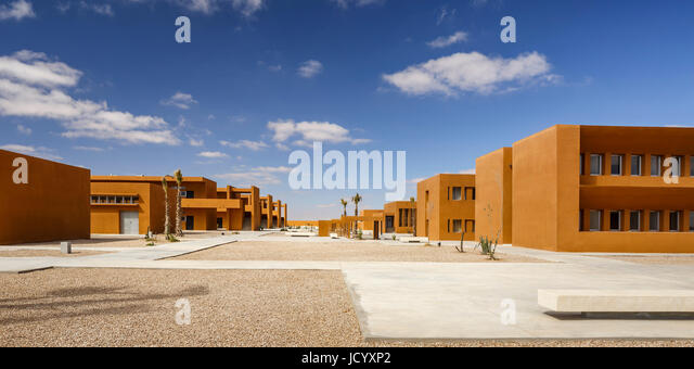 Panoramic view of campus with building cluster. Laayoune Technology School, Laayoune, Morocco. Architect: Saad El - Stock-Bilder
