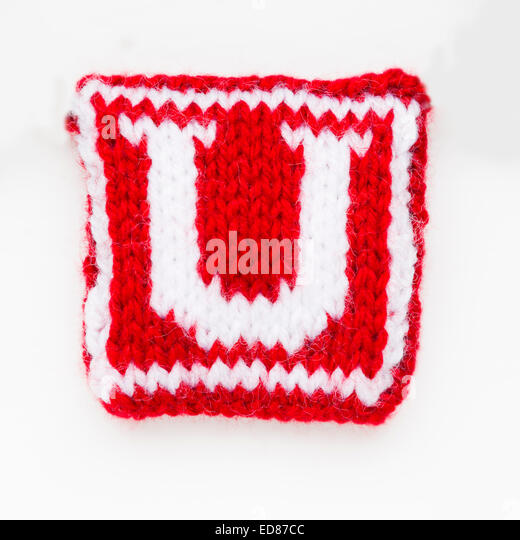 Knitted letter U woollen lettering. - Stock Image