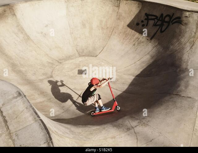 Young boy on a freestyle skateboard - Stock Image