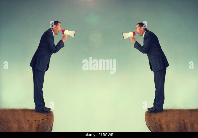 businessmen confrontation shouting at each other through loudhailers or megaphones business conflict concept - Stock-Bilder