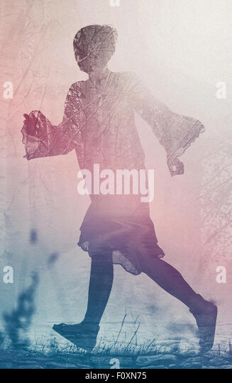 Woman Running to Freedom Through Countryside Field, Silhouette of Female Person, Double Exposure, Vintage Retro - Stock Image