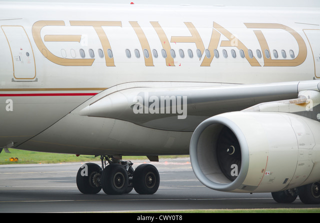 A close up of the Etihad logo on the fuselage of a passenger aircraft (Editorial use only) - Stock Image