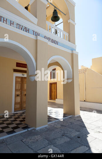 The shaded porch of an imposing building in the town of Oia, on the Greek island of Santorini - Stock Image