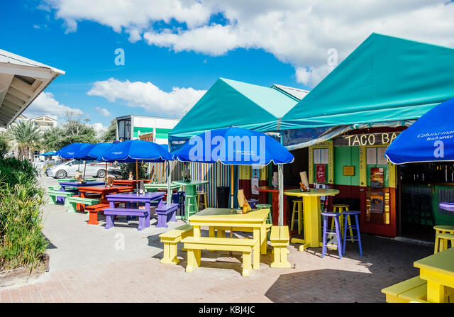 Empty tables at a Taco Bar in Seaside Florida, United States, a popular Gulf of Mexico panhandle tourist destination. - Stock Image
