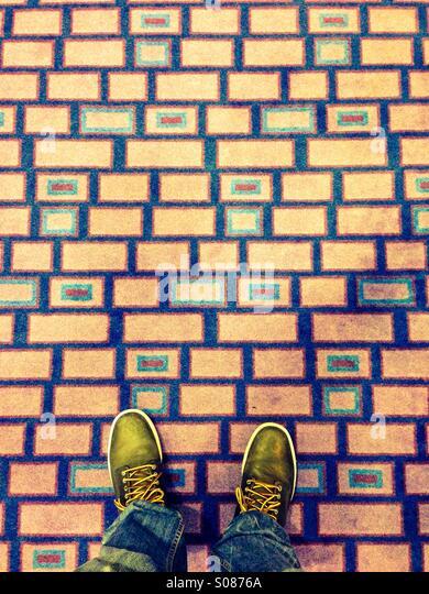 Mans shoes on colorful carpet - Stock-Bilder