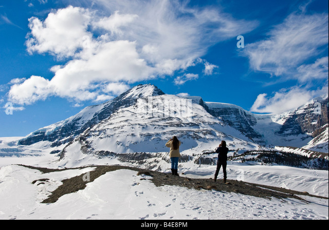 Two female photographers alone in the Columbia Icefield Canada on a perfect blue sky day with perfect weater  conditions - Stock Image