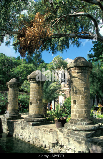 Antigua stone columns at admirals inn at English Harbour Nelsons Dockyard National Park historical site eastern - Stock Image