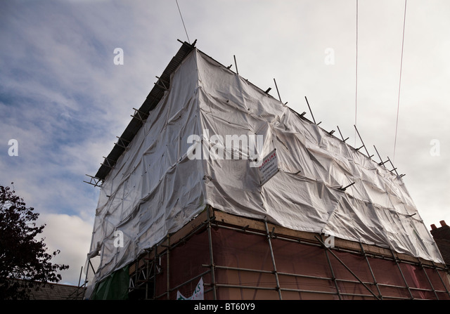 screened scaffolding on a small development - Stock Image