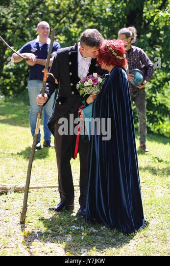 Groom kiss the bride - Stock Image