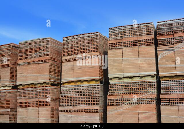 Stacked bricks on construction site stock photos stacked for Building design jobs