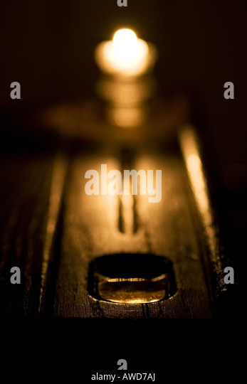 Old wooden school desk lit by candlelight. Yorkshire, England - Stock Image