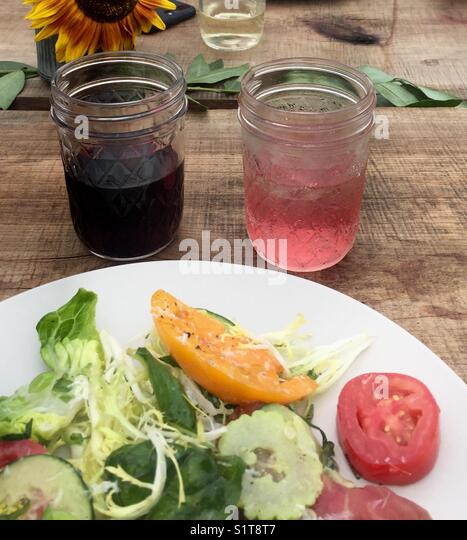 Red, rose wines and farm salad - Stock Image