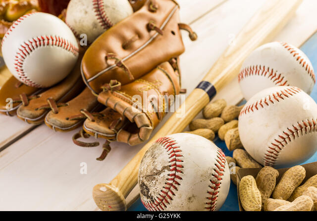 Close up of old worn baseball equipment on a wooden background. - Stock-Bilder