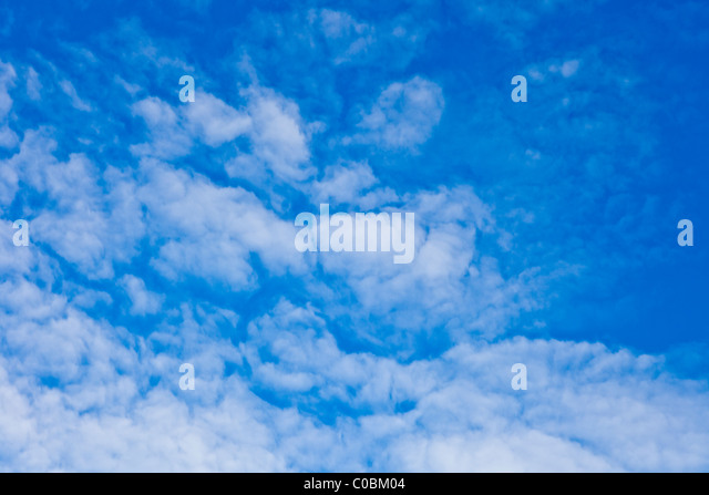 Low angle view of cumulus clouds - Stock Image