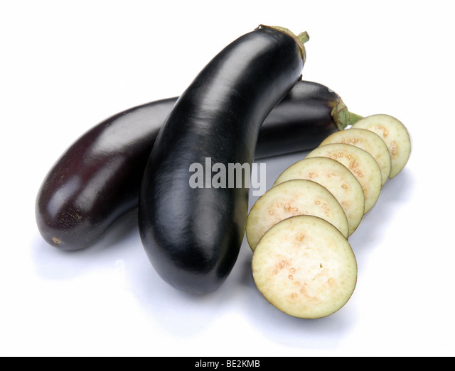 aubergine and slices on a white background - Stock Image