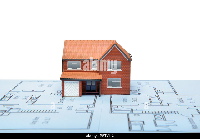 A model house on blueprints with white background - Stock-Bilder