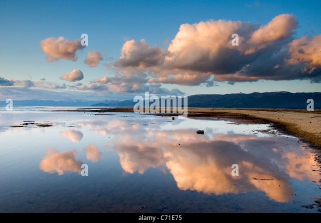 Large clouds reflecting in Lake Tahoe in late afternoon light, California. - Stock-Bilder