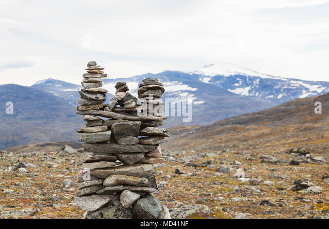 Stone cairn in mountain landscape, Jotunheimen National Park, Lom, Oppland, Norway - Stock Image