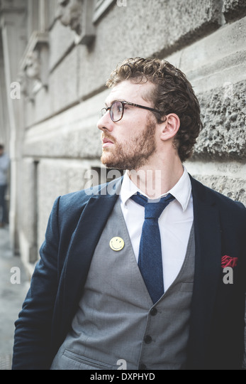 elegant attractive fashion hipster man lifestyle in the city - Stock-Bilder